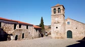 bell tower : Portuguese Church and bell tower from the 17th century at Freixo do Numao. Council of Vila Nova de Foz Coa. Portugal. Douro Region. Stock Footage