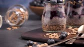 マヤの : Chia pudding with blueberries on dark table. 動画素材