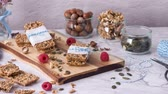 масло : Organic homemade granola bars on rustic marble stone kitchen countertop. Стоковые видеозаписи