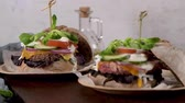 yogurt dishes : Healthy vegan burger with fresh vegetables and yogurt sauce on rustic kitchen counter top.
