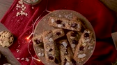 földimogyoró : Cereal bars with almonds, coconut and cranberries on a Christmas season table decorated with lights. Stock mozgókép