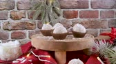 nut : Homemade candies with coconut roasted almonds on a Christmas season table decorated with lights. Stock Footage