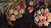 масло : Baked Christmas cookies on rustic dark background. Стоковые видеозаписи