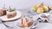 Delicious cake slice with pear, ginger and cinnamon on a plate in a dark kitchen counter. 動画素材