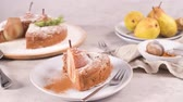 cannella : Delicious cake slice with pear, ginger and cinnamon on a plate in a dark kitchen counter. Filmati Stock