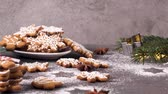 cannella : Christmas cookies on kitchen countertop with festive decorations. Filmati Stock