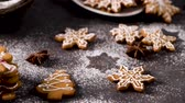 anice stellato : Christmas cookies on kitchen countertop with festive decorations. Filmati Stock