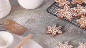 Christmas cookies on kitchen countertop with festive decorations. 動画素材