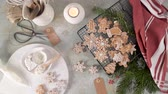 anice stellato : Christmas cookies on kitchen countertop with festive decorations.Christmas cookies on kitchen countertop with festive decorations. Filmati Stock