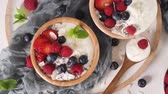jogurt : Yogurt with Chia seeds and fresh Strawberries, Raspberries, and Blueberries. Concept of Healthy Eating.