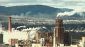 ambiental : a factory in action, releasing a lot of smoke and pollution in the atmosphere