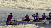 udatnost : Athletes competing an ice canoe race