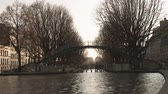 рамка : Bridge over the Saint Martin canal in Paris during winter. Pedestrian crossing and seagulls flying by.