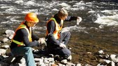 analyzing : Conservation workers taking water samples