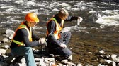ambiental : Conservation workers taking water samples