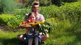 Little girl and mom growing their own food Стоковые видеозаписи