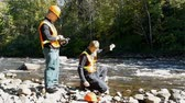 официальный : Conservation workers taking water samples