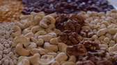 nut : cashew, walnut, peanuts.close-up.the camera moves around this to the right