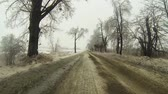 beira da estrada : A Point of View (POV) drive through an ice storm in winter