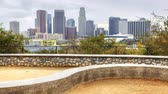 nowoczesne : 4K UltraHD View of Los Angeles skyline with stone dike in the foreground