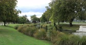 christchurch : Tree lined river in Christchurch, New Zealand downtown 4K