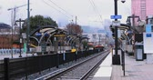 Rapid Transit station with Charlotte, North Carolina skyline 4K