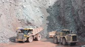 heavy : Earth mover loading a dumper truck ready to in a quarry, surface mine. typical mining industry. Located at Bebertal on April 12, 2014 Stock Footage