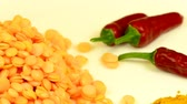 chilis : Red lentils and chilis on a turntable Stock Footage
