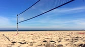 value : Beach volleyball court with net on a beach