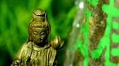 spirituality : Guanyin figure at a Chinese dragon well
