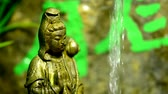 pipa : Guanyin figure at a Chinese dragon well