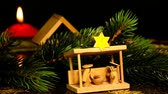 adwent : Crib, Christmas decoration with figures and hot red wine punch on turn table