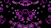 lilac : Dancing violet bubbles on a black background Stock Footage