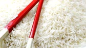 Çin yemek çubukları : rice with chop sticks on turn table