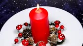 jellegzetes : Christmas decoration with advent wreath and burning candle on turn table Stock mozgókép
