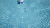 sol : exchange of chlorine tablets in the pool Stock Footage