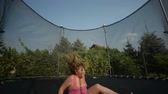 дети : Happy girl jumping in the trampoline