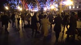 сторонник : UKRAINE, Odessa - 29 December 2017: People from the Hare Krishna movement dancing and singing on the street. Krishnas dance on the streets of Odessa, a religious festival, Ukraine