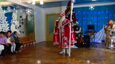 Ukraine, Odessa-December 2016: Christmas tree, Santa Claus on a childrens holiday. Children celebrate Christmas and new year having fun dancing with Santa Claus