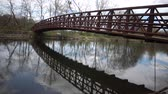 wooden bridge : Metal bridge over the canal, reflection of the bridge in the water, Karnegy Like, NJ USA