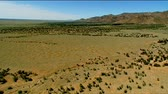 aerial : Aerial footage of flat dry country and rugged out back Australian mountain ranges, peaks, desert and Mallee areas. Flinders Ranges Area, featuring Wilpena Pound