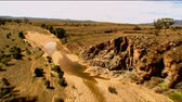 aerial : Aerial footage of rugged out back Australian mountain ranges, creeks, peaks, desert and Mallee areas. Flinders Ranges Area, featuring Wilpena Pound, Arkaroola, St Marys Peak and outback creek beds Stock Footage