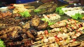 basting : Traditional Asian meat satay street food cooking outdoor at night. South East Asia