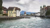 pontes : Jesuit church and Reuss river in Luzern, Switzerland.