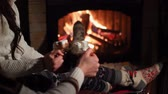 autumn : Young couple by the fireplace, drank hot drinks Stock Footage