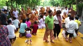 men : PATHUM THANI, THAILAND - JULY 12: People give food offerings in the morning for Lent Day At Wat Na Pa Pong. on July 12, 2014 Pathum thani Thailand. Stock Footage