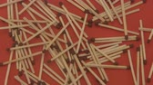 matchstick : Close up of a pile of wooden matches rotating on a red  background.