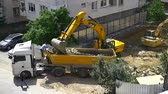 şantiye : ISTANBUL  MAY 6 2015: Many new constructions are underway. Istanbul is redeveloping neighborhoods to protect against a potential earthquake. Construction site with a tipper and digger loader. Slow Motion View Stok Video