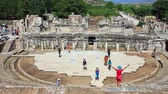 ephesus : EPHESUS, TURKEY - Jun 15, 2014: Most magnificent structure in the ancient city of Ephesus. The Great Theatre is located on the slope of Panay Hill, opposite the Harbor Street, and easily seen when entering from the south entrance to Ephesus. Stage Theater Stock Footage