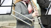 woodwind : A band of musicians performing in the streets. Focus on clarinet player
